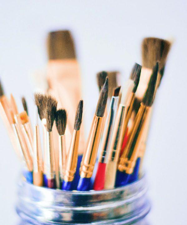 Shallow Photography of Brushes on Jar